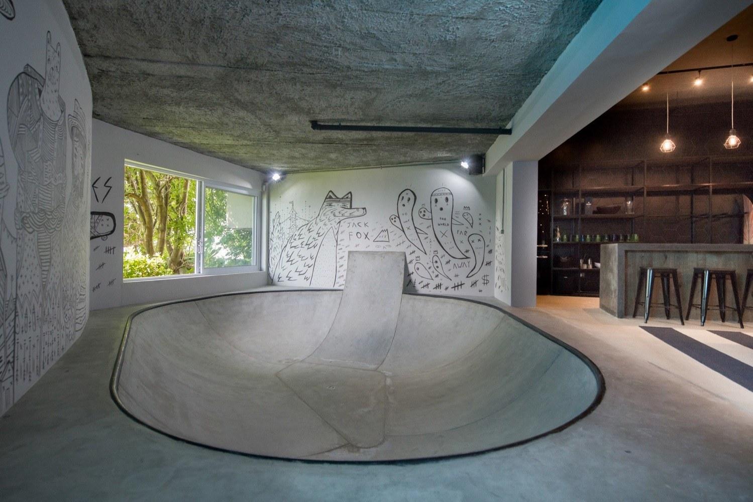indoor skate park with custom wall art