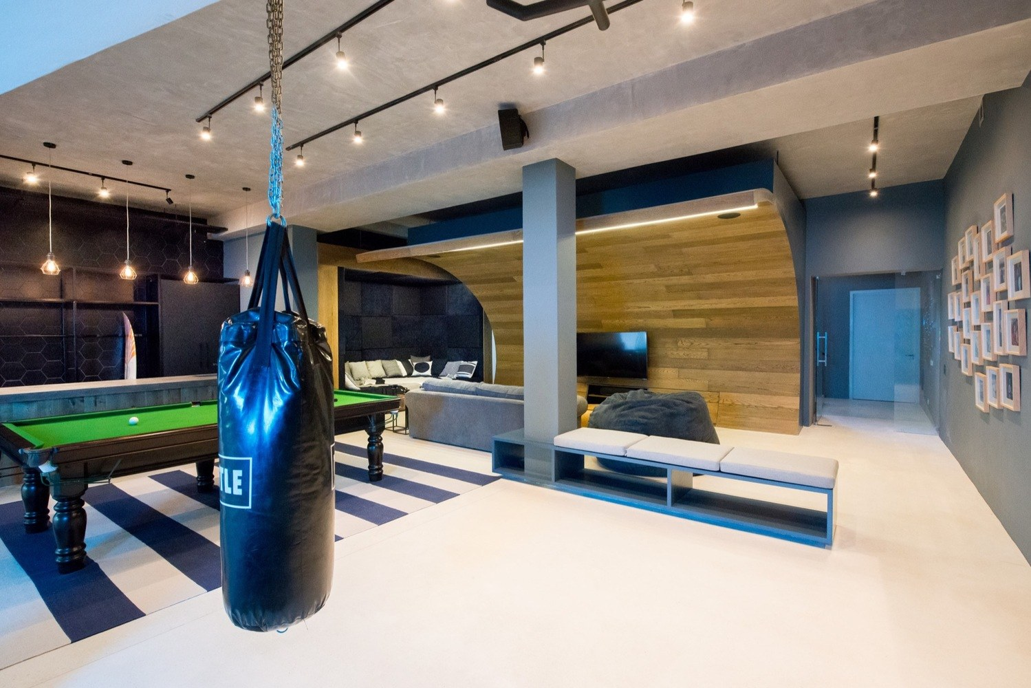 boxing bag and pool table in urban man cave
