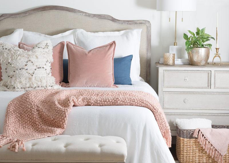 Millennial pink pillows and throw